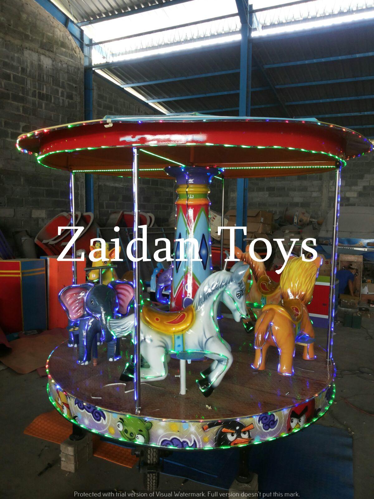 Pabrik mainan wisata anak terbaik dan terpercaya Surabaya menjual komedi putar carousel mini 6 penumpang harga murah dan berkualitas.
