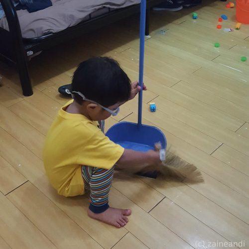 charming little boy_cleaning