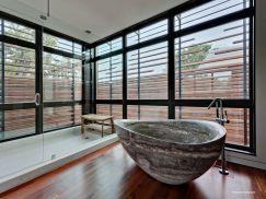 Modern-Bathroom-with-Stone-Bathtub pierre baignoire