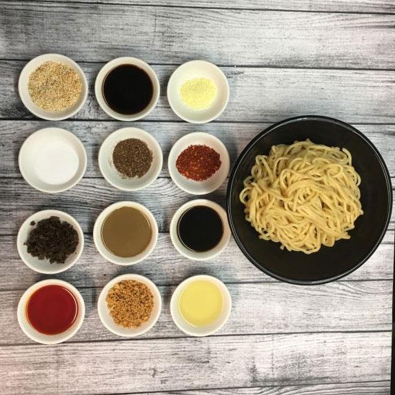 Dan Dan noodles next to sauce ingredients