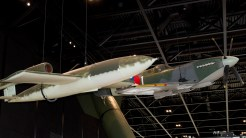 V-1 Flying Bomb with Dutch Spitfire tippping the wing