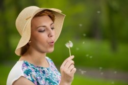 Writing with Splash: using Sensory Language Girl blows a dandelion
