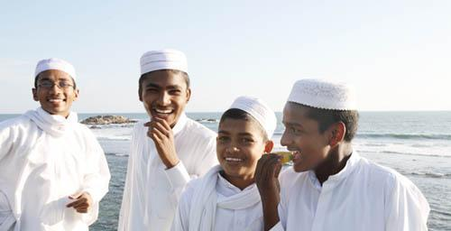 Muslim teenage boys at the seashore in Sri Lanka