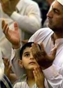 Muslim boy and father saying dua