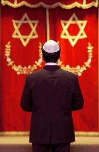 A Jewish man praying in a synagogue