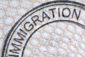 Passport immigration stamp, green card