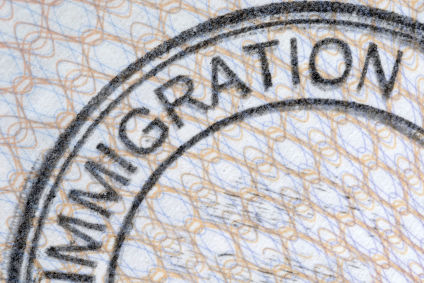 Passport immigration stamp, green card