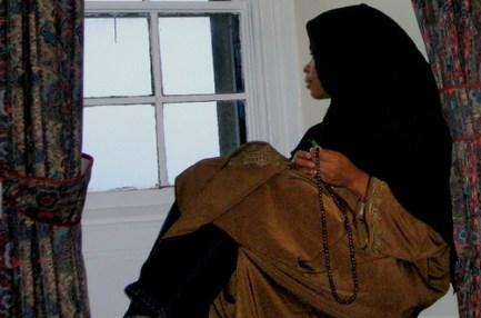 Muslim woman, alone, lonely, thoughtful