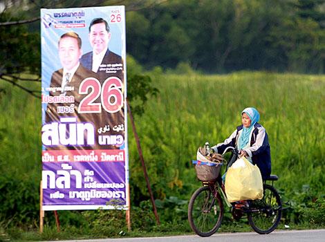 Thai Muslim woman on a bicycle