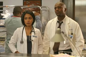 Sout Asian woman with black man, Indian woman, two doctors