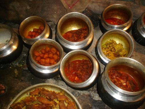 Several Kashmiri wazwan dishes being prepared