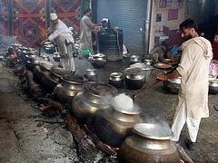 Preparing wazwan for a Kashmiri wedding