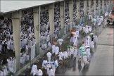 Pilgrims converge on Hajj rain shelters.