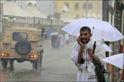 A pilgrim talks on his mobile phone before taking part in the Hajj