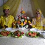 Malaysian Muslim couple at their wedding