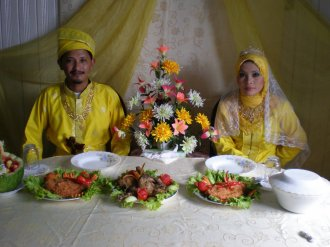 Malaysian Muslim couple at their wedding