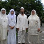 Malaysian Muslim parents at their son's wedding