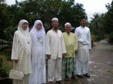 Malaysian Muslim parents and groom at their son's wedding