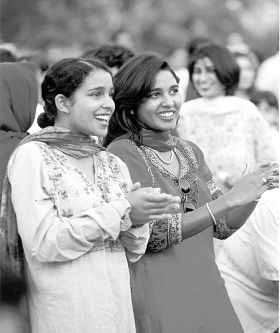 Two Gujarati girls clapping at the annual Gloucester festival