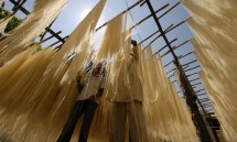 Workers dry vermicelli in Hyderabad during Ramadan