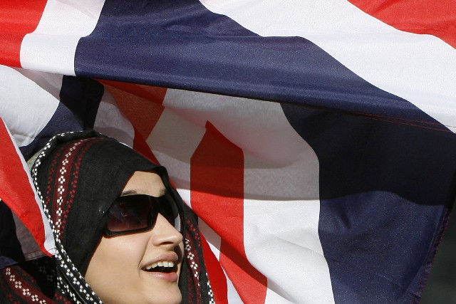 British Muslim woman with the flag
