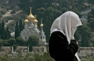 Palestinian girls prays at Al-Aqsa mosque in Jerusalem during Ramadan