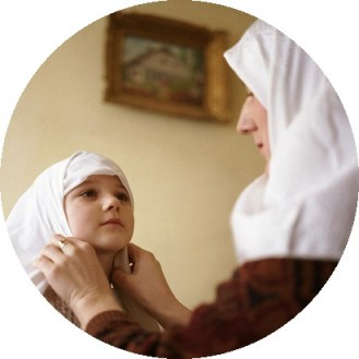Muslim mother adjusts her daughter's hijab