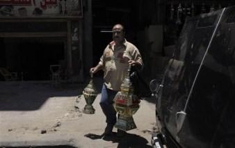 Egyptian man buying Ramadan lanterns