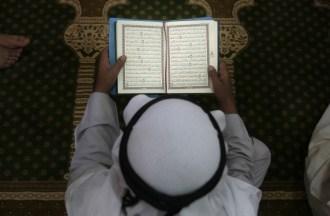 Palestinian man reads Quran