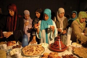 Muslim women having Ramadan iftar in Italy