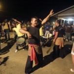 Surinamese Muslims of Javanese origin sing and dance during Eid al-Fitr celebrations in Wanica