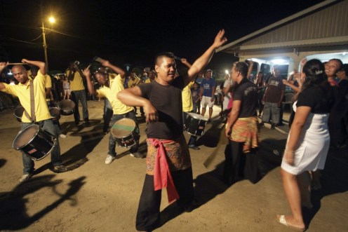 Surinamese Muslims of Javanese origin sing and dance during Eid al-Fitr celebrations in Wanica