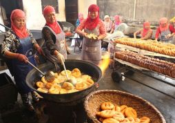 Muslim women preparing a kind of frybread for Iftar.