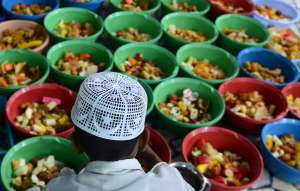 A boy in Allahabad, India prepares iftar bowls for breaking fast in Ramadan.