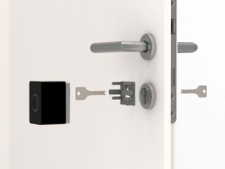 the intelligent door lock is simply placed on the inside of a door on the existing Castle and attached to the cylinder with three screws (image: Nuki)