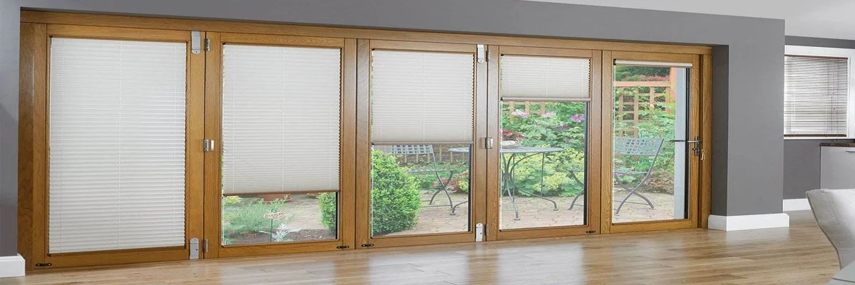 are patio doors with blinds inside a