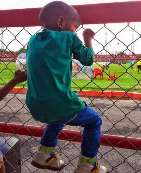gerard and funashi watching football at nkana