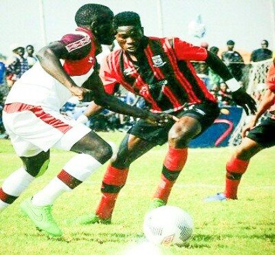 Salulani vies for the ball against Nkana