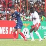 Ronald Kampamba try to reach for the ball during Nkana vs Belouizdad