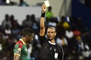 Janny Sikazwe using the Laws Of the Game to officiate international matches