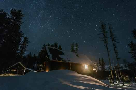 Cozy cabin under the stars outside of Whitefish, MT taken on the Rokinon 12mm lens