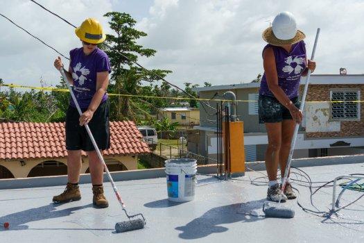 All Hands Volunteers Sealing a Roof in Puerto Rico