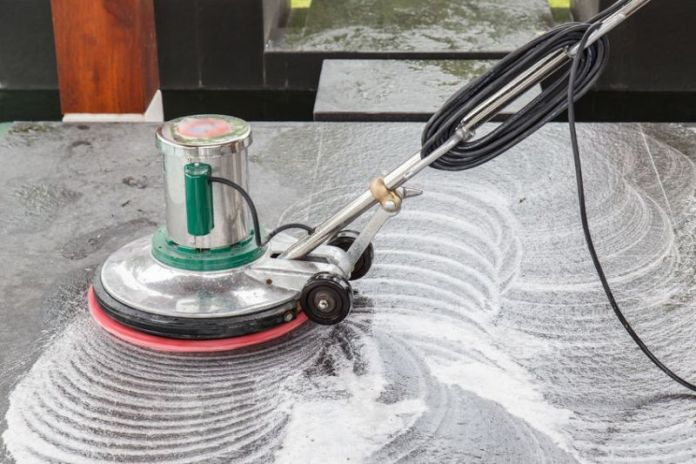 33242269 - thai people cleaning black granite floor with machine and chemical