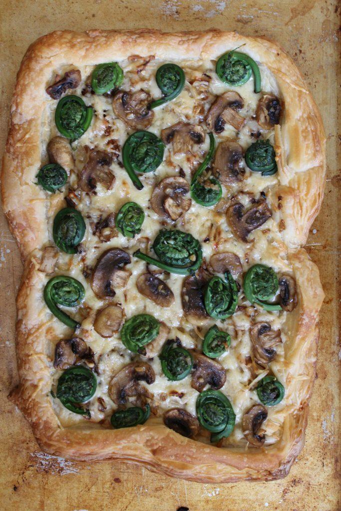 Fiddlehead, Mushroom, Caramelized Onion & Gruyere Tart
