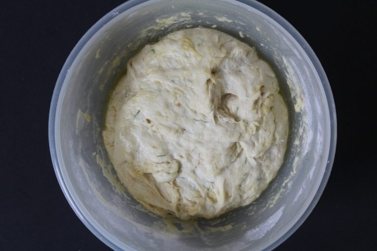 Garlic Dill Focaccia raw dough in a bowl