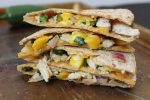 Jerk Chicken and Mango Quesadillas - chicken seasoned with jerk spice, fresh mango salsa, and cheddar cheese combine to make the tastiest quesadillas you will ever devour!