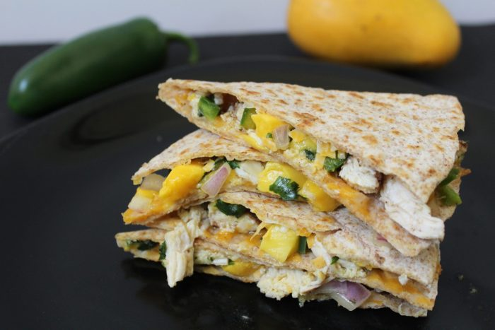 Jerk Chicken and Mango Salsa Quesadillas - chicken seasoned with jerk spice, fresh mango salsa, and cheddar cheese combine to make the tastiest quesadillas you will ever devour!