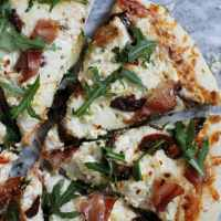 Three Cheese Pizza with Prosciutto, Sun Dried Tomatoes and Arugula