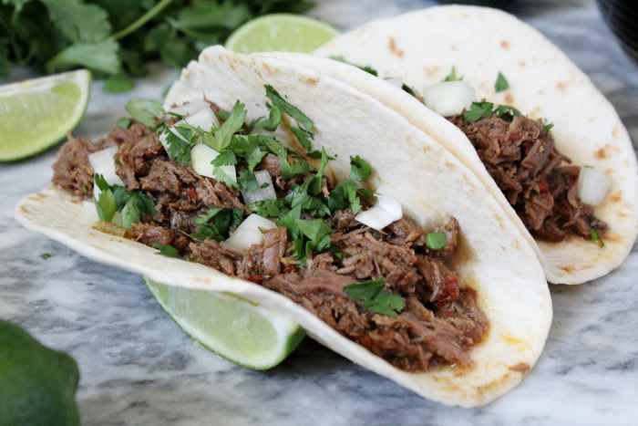 Instant Pot Beef Barbacoa Tacos - Taco Tuesday just got better! This recipe for beef barbacoa has tons of flavour and makes those weeknight dinners simple through cooking with the Instant Pot. Not only is this easy to make, it's perfect for leftovers and you can use the beef in so many different ways - quesadillas, nachos, burritos and the list goes on!