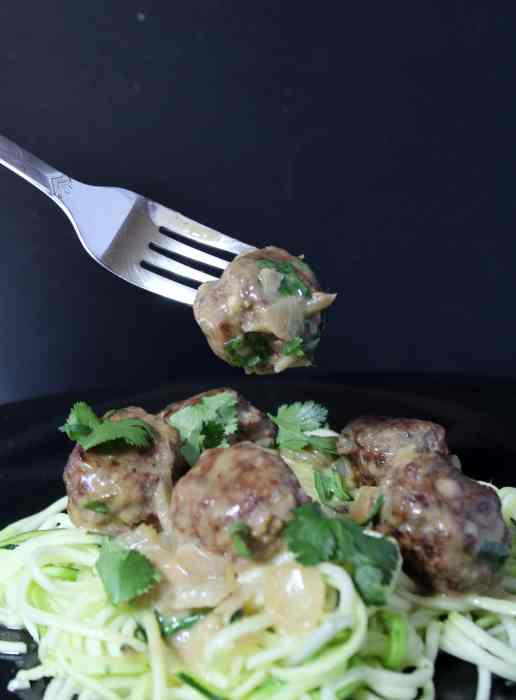 Thai Green Curry Meatballs with Zoodles - A hearty yet healthy dish! These meatballs are flavourful and paired with creamy Thai green curry sauce are an interesting way to switch up dinner from the regular spaghetti and meatballs.